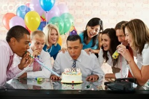 Birthday Party in Office --- Image by © Tim Pannell/Corbis